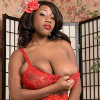 Ebony MILF Janet Jade revealing massive titties while attired tights and garters