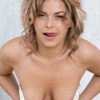 Ash-blonde amateur Ayda slurps her lips former to a close up of her finger spread twat