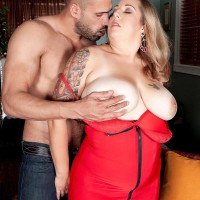 Sandy-haired BIG SEXY LADY Dani Moore uncovers her giant boobs before giving a blowjob in lingerie