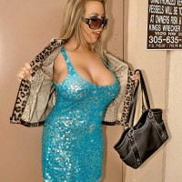 Sandy-haired beauty Amber Lynn Bach flashing big breasts to seduce younger stud