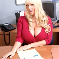 Blond manager woman Karen Fisher revealing large tits while seducing employee