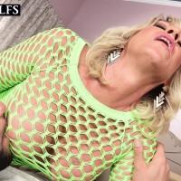 Fair-haired cougar Brandi Jaimes seduces a stud in a see-through mesh dress and high-heeled shoes