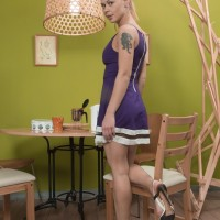 Golden-haired European amateur Nikitina unsheathing furry cootchie from panties in high heeled shoes