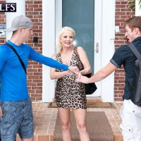 Yellow-haired granny Cammille Austin jacks a pair of knobs after seducing dudes in a sundress
