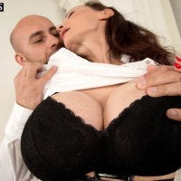 Dark haired cougar Michaela O'Brilliant having huge tits unsheathed before giving BJ