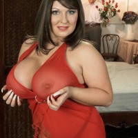 Brown-haired MILF Angel Gee baring gigantic breasts from semi-transparent sundress for nipple slurping