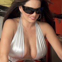 Dark-haired MILF Mia Starr revealing large natural tits on motorcycle in sunglasses