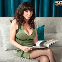 Brunette MILF over Fifty Karen Kougar seducing junior guy for sex on chesterfield