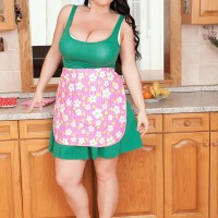 Black-haired solo chick Juliana Simms letting big titties free from sundress in kitchen