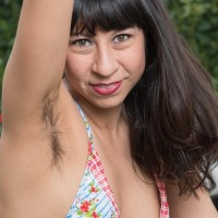 Dark haired solo chick Vivi Marie showcasing fur covered pits and spread fuckbox outdoors