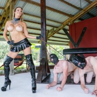 Huge-titted yellow-haired Alexis Fawx keeps a duo of males submissives in rubber hoods on leashes