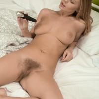 Chesty Euro amateur Darina Nikitina dildoing hairy honeypot while masturbating