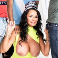 Huge-boobed grandma Rita Daniels deep-throats on large white and ebony cocks for bday number Sixty-nine