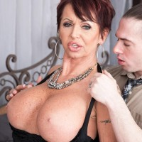Fancy expert dame Gina Milano tempts a junior guy with her gigantic boobs