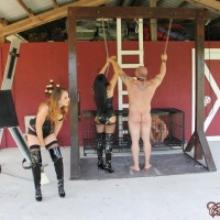 Non nude dolls Michelle and Lacy plus a mistress dominate naked boys outdoors