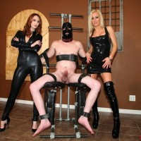 Fully-clothed gals Zoey and Kendra refuse a hooded masculine slave from having an climax