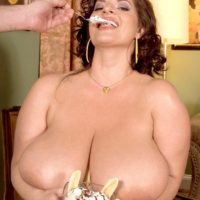 Bootylicious female Maria Moore touting monster-sized boobs while licking food and giving BLOW JOB