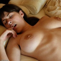 Dark-haired first timer tweaks her hard nips before letting out her cute ass and furry cooch