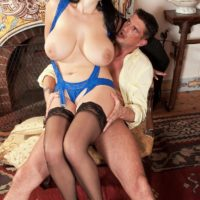 Brown-haired MILF Shione Cooper touting gigantic tits for nip licking in stockings