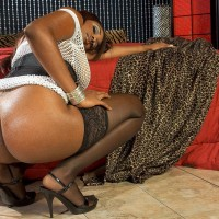 Black MILF Leah Ray flaunts her huge derriere during solo activity in nylons and high-heels