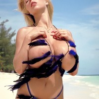 Well known ash-blonde adult flick star Tiffany Towers vaunting hooters outdoors on beach