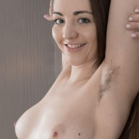 Flexible amateur model Virgin Bloom shows her wooly armpits and furry cunt in the nude
