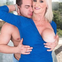 Insatiable 60 plus MILF Leah L'Amour tempts a younger boy in the sauna before providing a ORAL PLEASURE