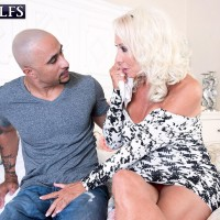 Inviting 60 plus MILF Madison Milstar tempts a younger black boy in a taut fitting dress