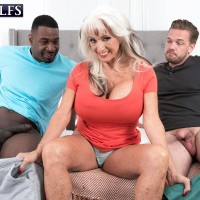 Beguiling 60 plus MILF Sally D'Angelo deep-throats on a BBC and a hefty milky penis simultaneously
