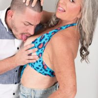 Stellar 60 plus MILF Silva Foxx tempts a younger dude by flashing her titties in a denim microskirt