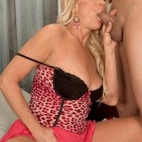 Wondrous light-haired granny with excellent legs Natasha entices a blows a younger ebony man
