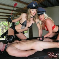 Stunning blondes Virgin Morgan and Alina top a masculine slave outdoors in latex fetish wear