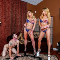provocative blondes Mickey Tyler and Kelly Paige dominate a masculine submissive in USA themed bathing suits