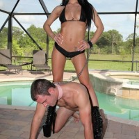 Sexy brunette Adriana Lynn makes a collared male submit to her will in stiletto boots