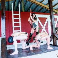 Fabulous black-haired Dominant Dava FoXX abusing and abjecting TWO masculine slaves