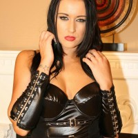 Tempting black-haired Wife Ashley plays with her hard nips in leather and stockings