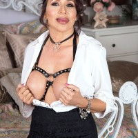 Sexy grandmother Lisa Marie Heart entices a younger boy in a choker and bondage harness