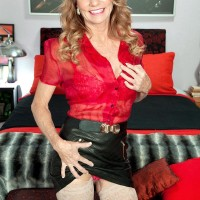 Killer elder dame Denise Day entices a younger stud in leather micro-skirt and hose