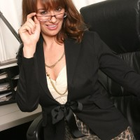 Gorgeous accomplished dame strips to her ebony tights only in her home work environment