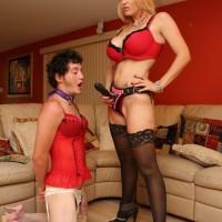 Killer gf Charlee Chase makes crossdressing sissy eat a strap on penis on his knees