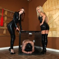 Spandex attired Dominas Zoey and Kendra milking off restrained and hooded masculine submissive