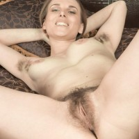 Lumbering amateur Donatella doffs high heels to exhibit her wooly pits and pubic hair in the nude