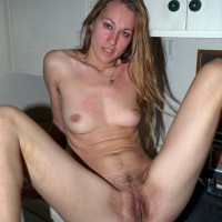 Gawky first timer showcases off her hairy pits and natural cunt on top a bed
