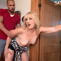 Aged platinum-blonde cougar Rebecca Williams seducing younger man for sex on bed