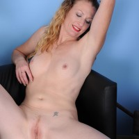 Experienced platinum-blonde housewife sports crimson lips while undressing naked for the first time