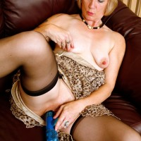 Elderly platinum-blonde gal hikes up her sundress in order to toy her cooter in black nylons