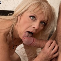 Older fair-haired gal gobbles and deep throats on a humungous cock in her black hosiery