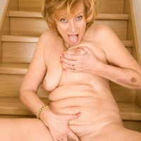 Elder ginger-haired doffs a sundress and pretties to pose totally naked on wooden stairs