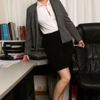 Mature secretary makes her naked strutting debut while at work during solo activity