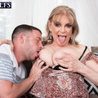 Senior doll Crystal King has her gigantic titties toyed with by a junior boy